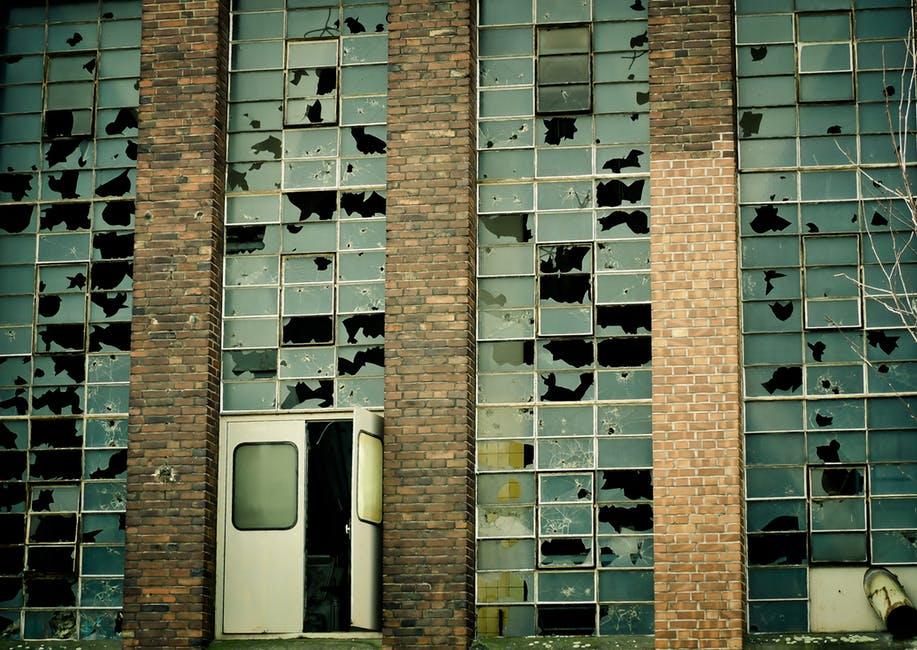Description: A tall building with many broken windows
